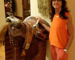 Kathy Baker with a parade saddle