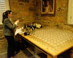 Traci Dutton preparing to uncork the wines