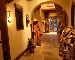The hallway featured lifesized costumes and saddles along with miniature salesman's saddle samples