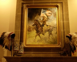 Painting by Z. S. Liang surrounded by two Indian American Eagle Headdress